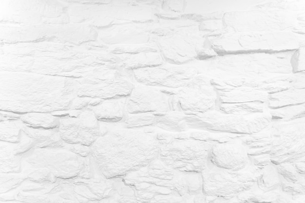 Białe tło bielone tło kamiennego muru szorstka tekstura