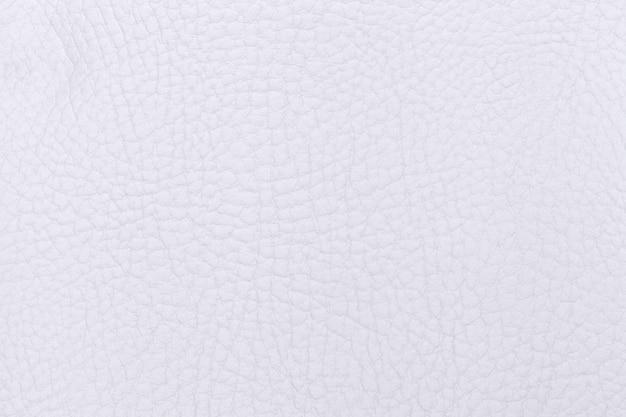 Białe tło matowej skóry z materiału tekstylnego. materiał o naturalnej fakturze. zasłona.