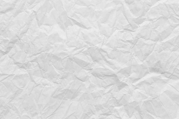 Białe tło pomarszczony papier do projektowania koncepcji tekstury.