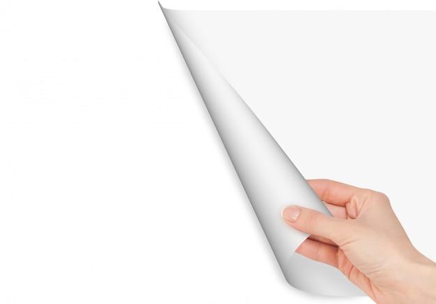 Białe tło. ręka otwiera stronę