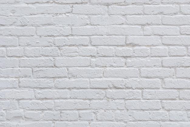 Białe tło ściany z cegły na poddaszu