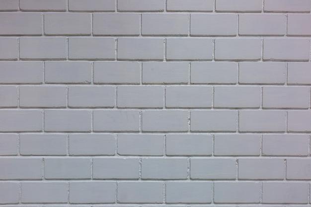 Białe tło ściany z cegły w pokoju hotelowym