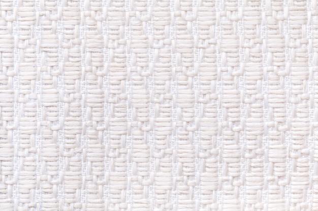Białe tło z dzianiny wełnianej z wzorem miękkiej, miękkiej tkaniny.