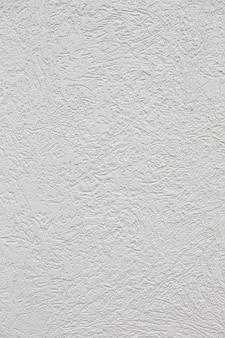 Białego cementu tynku ściany vertical tło