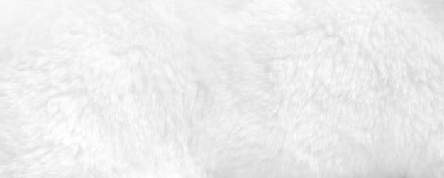 Białego futerka tła zakończenie w górę widoku