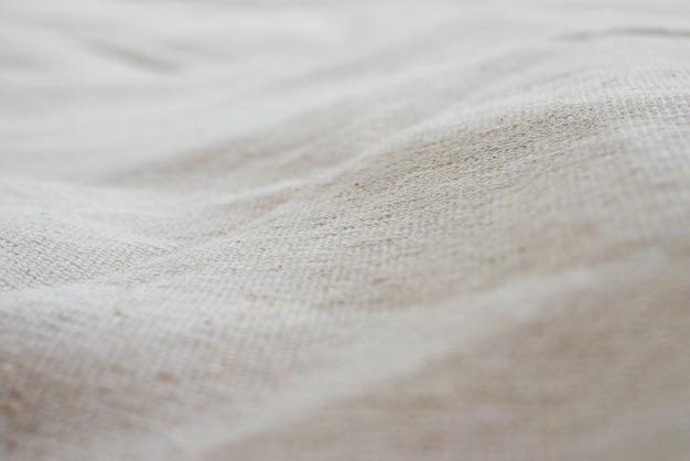Białej perkalowej tkaniny tła sukienna tekstura