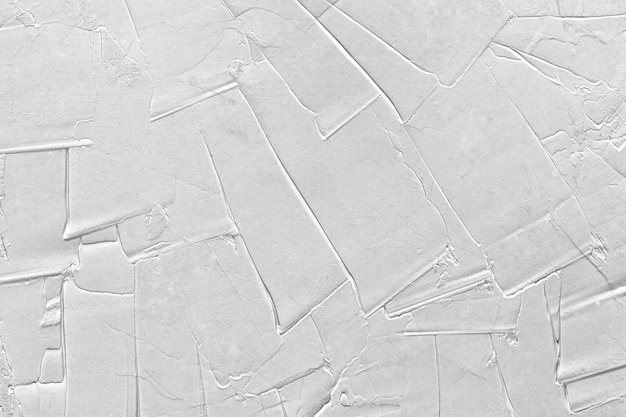 Biało-szara tekstura silikonowego tynku z głębokimi zadrapaniami