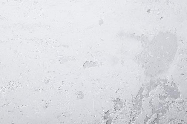 Biały czysty betonowy mur z szorstką teksturą, tle ściany lub podłogi