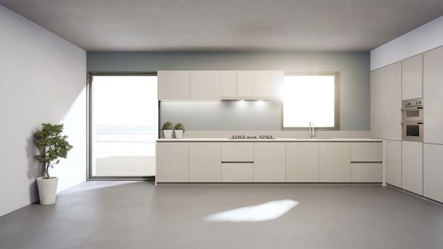 Biały czysty blat i drewniana szafka nowoczesnej kuchni z widokiem na morze w luksusowym domu na plaży.