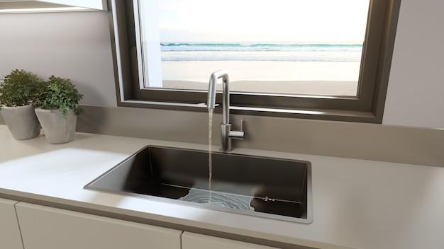 Biały czysty blat i szafka nowoczesnej kuchni z widokiem na morze w domu na plaży.