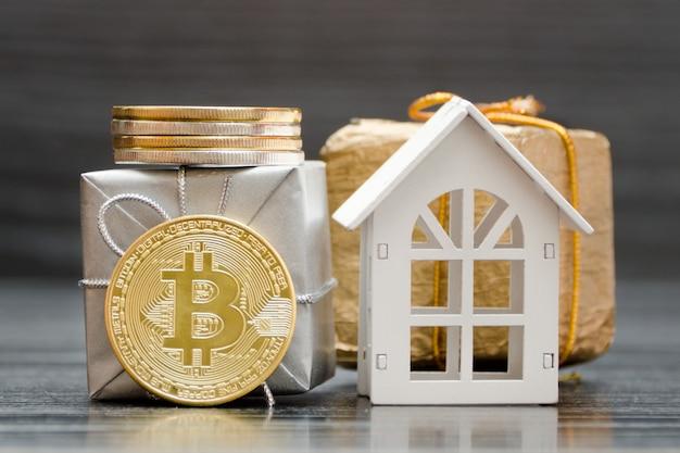 Biały dom, monety bitcoin i prezenty