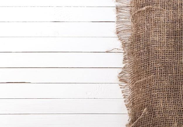 Biały drewniany tło z płótnem