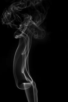 Biały dym na czarnym tle