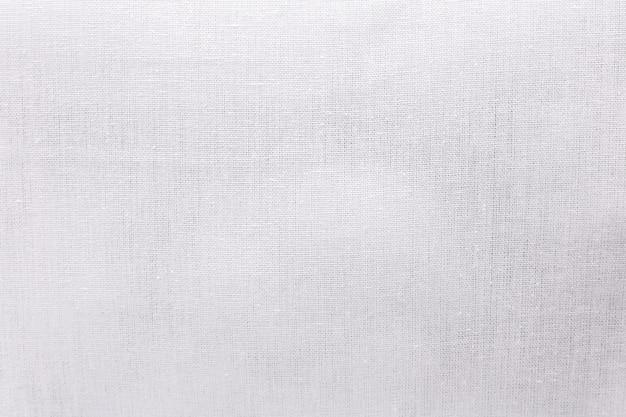 Biały ekologii tkaniny tekstury tło. pusty materiał tekstylny lub tkanina perkalowa.