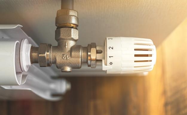 Biały grzejnik z termostatem w domu, nowoczesne zdjęcie tła wnętrza