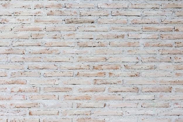 Biały i brown ściana z cegieł tło, tło stara rocznik ściana z obieranie tynkiem