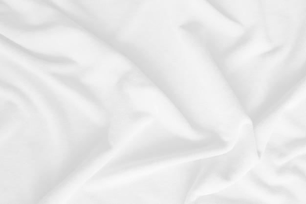 Biały koc kudłaty tekstury jako tło fluffy fałszywe futro włókienniczych nieostrość selective focus