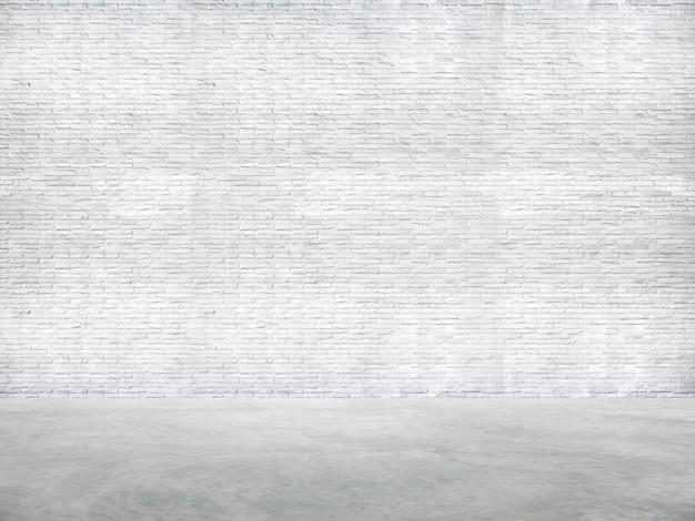 Biały mur z cegły i podłoga cementowa