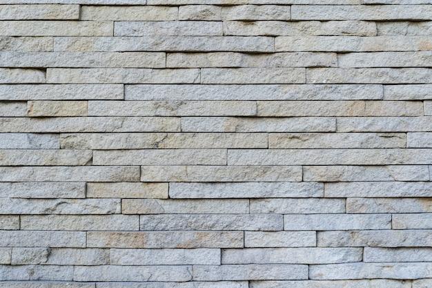 Biały mur z cegły. tekstura cegły z białym wypełnieniem