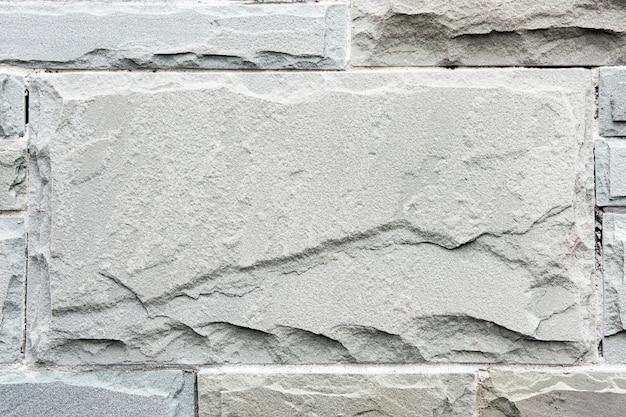 Biały mur z cegły z piaskowca teksturowane tło