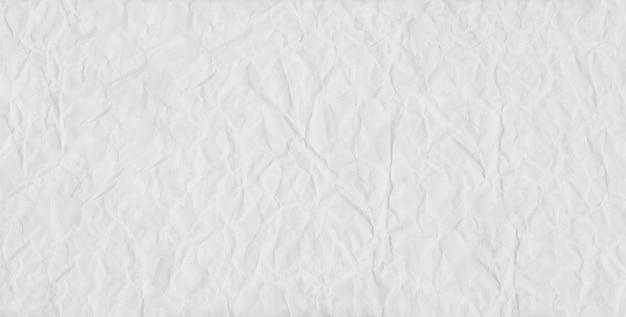 Biały papier fałdowy i zmięty tło.