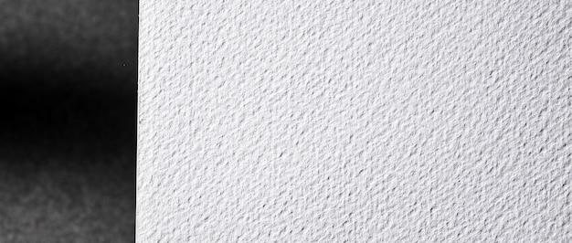 Biały papier teksturowany z bliska leżał płasko