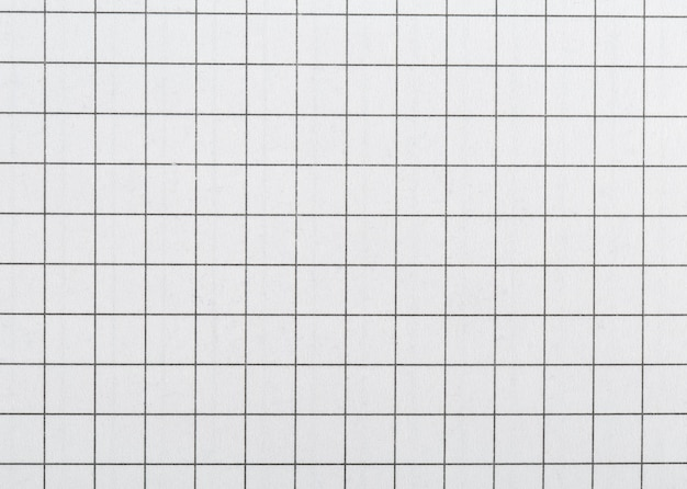 Biały papier w klatce do pisania.
