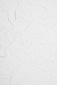 Biały pionowy papier pomarszczony