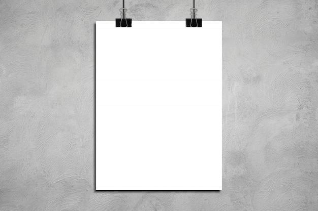 Biały plakat na betonowej ścianie