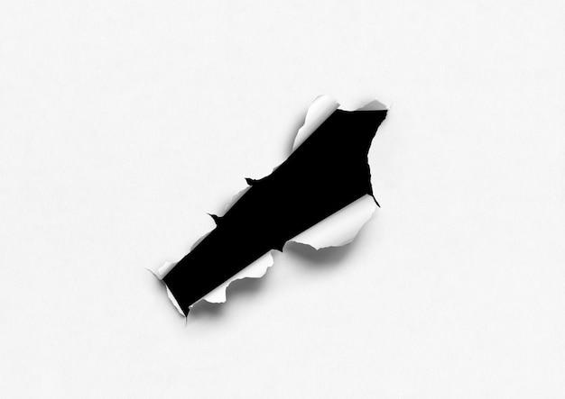 Biały podarty papier z czarną dziurą