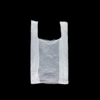 Biały półprzezroczysty plastikowy worek na czarnym tle odizolowywającym