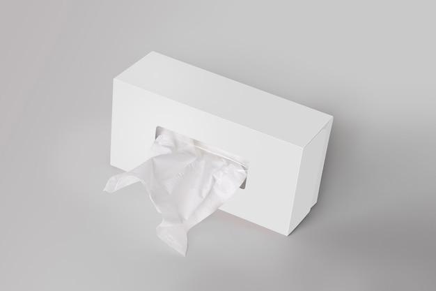 Biały pusty tkanki pudełko na szarym tle z twarzową tkanką