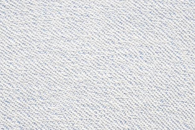 Biały sweter z dzianiny bawełnianej teksturowanej tło, projektowanie tkanin moda