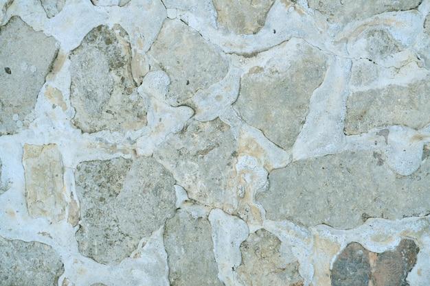 Biały szary kamień otynkowany ściana, tekstura, tło.