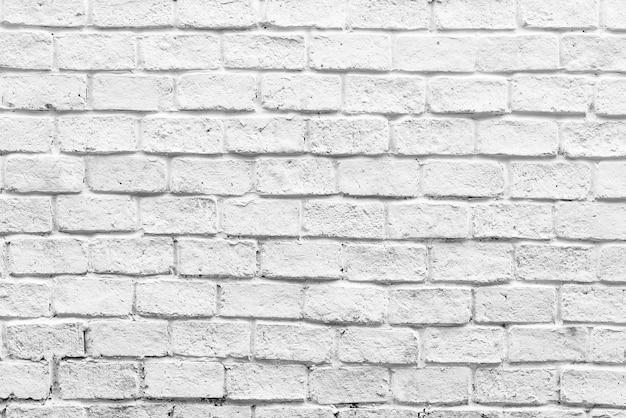 Biały tle ceglanego muru