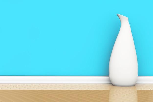 Biały wazon na podłodze i niebieska ściana
