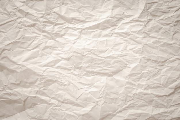 Biały zmięty stary z teksturą strony papieru