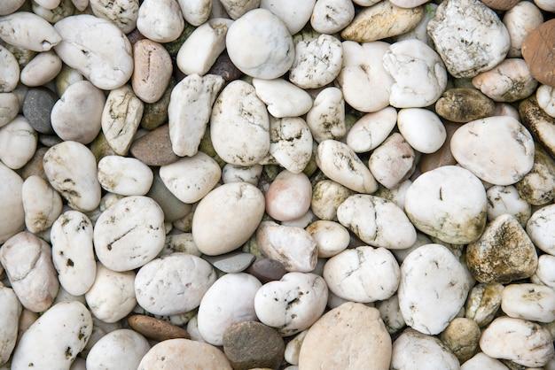 Biały żwiru kamień tło. tekstury i motyw materiałowy