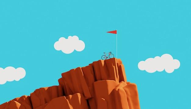 Bicykl na górze góry z flaga, zwycięzcy pojęcie