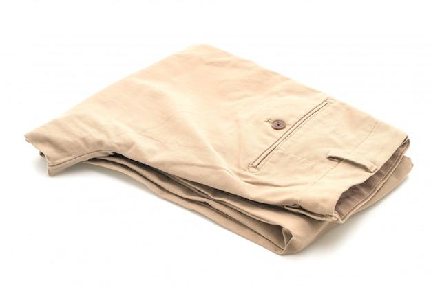 Biege spodnie na białym tle
