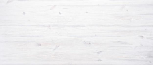Biel malował drewnianego biurka tła tabletop lekkiego pustego nieociosanego drewnianego tekstura szalunku deski powierzchni deski pustego stołowego chodnikowa z kopii przestrzenią, odgórny widok