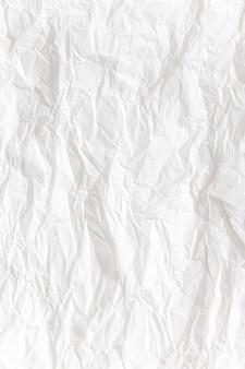 Bielu zmięty papieru zakończenie w górę tekstury tła