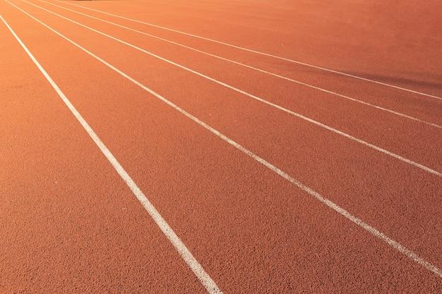 Bieżnia Dla Tekstury Sportowej Konkurencji. Wyścig Do Treningu Sportowego Z Kopią W Tle Pasa Premium Zdjęcia
