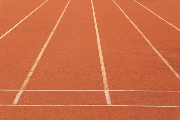 Bieżnia dla tekstury sportowej konkurencji. wyścig do treningu sportowego z kopią w tle pasa