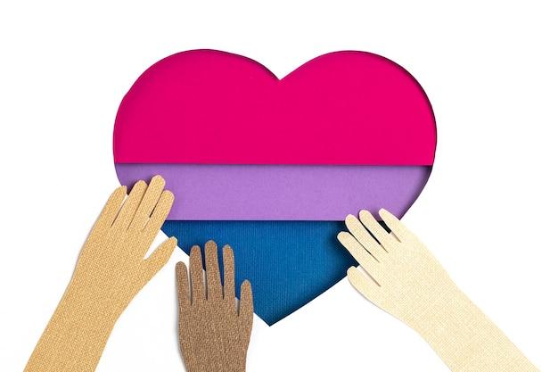 Biseksualna flaga w formie wyciętego papieru w kolorach niebieskim, różowym i fioletowym. miłość, duma, różnorodność, tolerancja, pojęcie równości