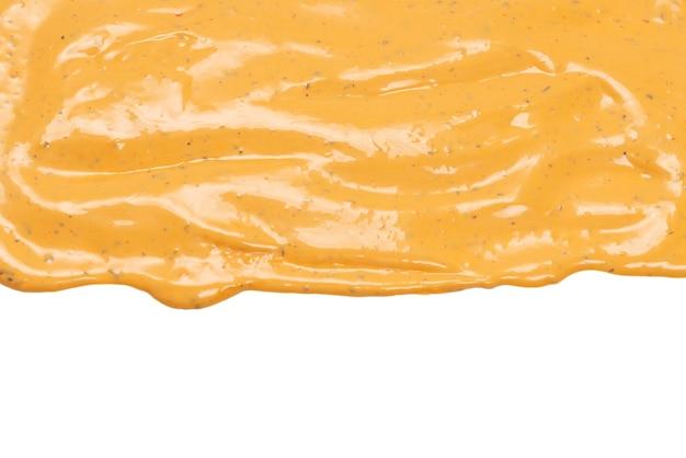 Bita pyszne plamy sosu na białym tle na białym tle. tło sos hamburgerowy.