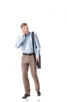 Biznes człowiek działa i rozmawia przez telefon