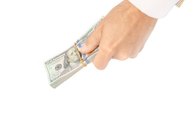Biznes dolarów pieniędzy w rękach na białej powierzchni