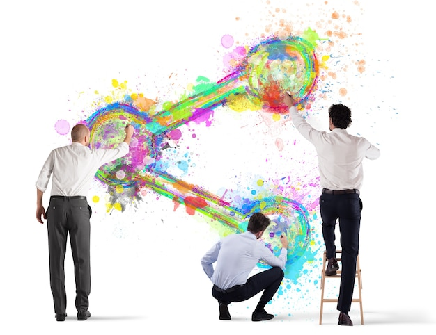 Biznes osoba malować ikonę akcji na ścianie na białym tle na białej powierzchni
