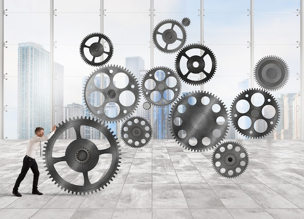 Biznesmen buduje system biznesowy jako mechanizm przekładni